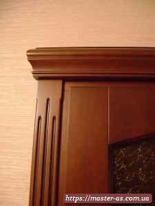 Резьба на наличниках дверной коробки